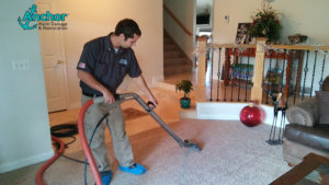 Anchor Restoration personnel cleaning carpet