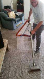 professional carpet cleaning using vacuum