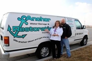 anchor restoration founders in front of the van